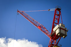Red crane on a blue sky Royalty Free Stock Photo