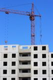 Red crane and blue sky on building site Royalty Free Stock Images