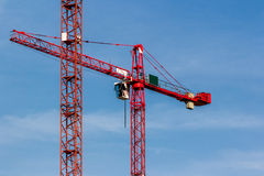 Red Crane on Blue Sky. Detail of red cranes on a blue summer sky Stock Photo