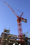 Red crane on buidling site Royalty Free Stock Image