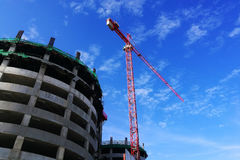 Red crane at construction building Royalty Free Stock Photo