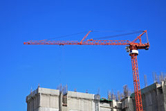 Red crane at Construction site Royalty Free Stock Photos