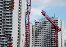Red crane at construction site with building development Royalty Free Stock Photos
