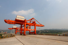 Red Crane. The red crane erect on the port stock photography