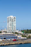 Red Crane in Front of San Juan High Rise. A red construction crane in front of a San Juan, Puerto Rico high rise condo building royalty free stock image