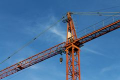 Red crane under a blue sky Royalty Free Stock Photography