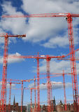 Red cranes on contruction site Royalty Free Stock Images