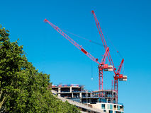 Red cranes in London on June 14, 2013 Stock Photos