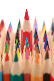 Red crayon standing out from the crowd Royalty Free Stock Photography
