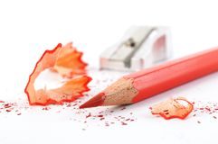 Red crayon wiht shavings Stock Photos