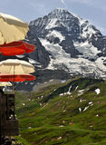 Red and cream umbrellas on mountain Royalty Free Stock Photos