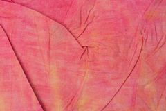 Red creased painted textile background. Red color painted textile background stock images
