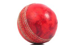 Red cricket ball. Old shiny red cricket ball that has been well used Stock Photos