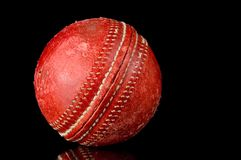 Red Cricket ball on black background Stock Images