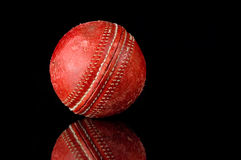 Red Cricket ball on black background Stock Image