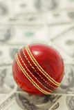 Red Cricket Ball and Money royalty free stock photography