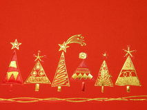 Red Cristmas paper. Red festive Cristmas paper with golden fir tree Royalty Free Stock Photography