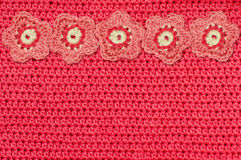 Red crochet fabric and handmade flowers Stock Images