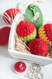 Red crocheted easter eggs in a shabby wooden box Stock Photo
