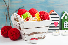 Red crocheted easter eggs in a shabby wooden box Royalty Free Stock Images