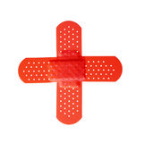 Red cross. Formed by two bandages isolated on white background Royalty Free Stock Photos