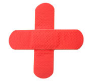 Red cross. 2 red bandaids over each other in the form of the red cross Royalty Free Stock Images
