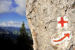 Red cross and arrow hiking symbols Stock Photos