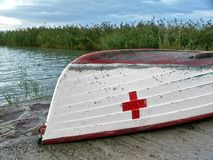 Red cross on a boat. At the beach Royalty Free Stock Image