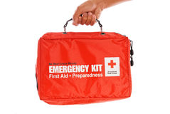 Red Cross Emergency Kit. In Male Hand royalty free stock images