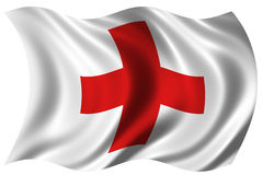 Red Cross Flag. The Internationally recognised Red Cross flag billowing in the wind Stock Image