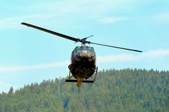 Red cross helicopter landing. Forest in background Stock Images