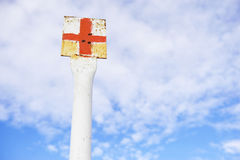 Red cross marking pole Stock Photo