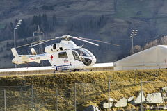 Red Cross medic MD Helicopter MD Explorer by McDonnell Douglas Helicopter Systems stands on heliport Stock Images