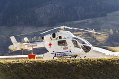Red Cross medic MD Helicopter MD Explorer by McDonnell Douglas Helicopter Systems stands on heliport Royalty Free Stock Photos
