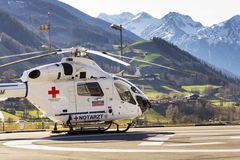 Red Cross medic MD Helicopter MD Explorer by McDonnell Douglas Helicopter Systems stands on heliport Stock Photo