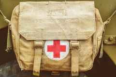 Red cross medical aid symbol on an old army bag. Red cross medical aid symbol on a vintage jute army bag Royalty Free Stock Photos