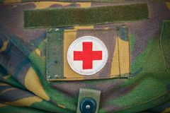 Red cross medical aid symbol on a vintage jute army bag Royalty Free Stock Photo