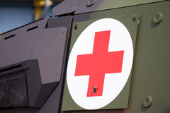 Red cross on a military armored vehicle Royalty Free Stock Photo