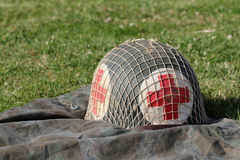 Red cross military helmet Stock Image
