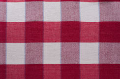 Red cross plaid pattern - Red Tartan Clothing Table. Plaid is a pattern consisting of crossed horizontal and vertical bands in two or more colours in woven Stock Images
