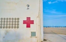 Red cross post on the Malvarrosa beach in Valencia