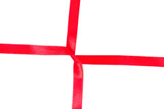 Red cross satin ribbon over white background Royalty Free Stock Photos
