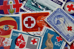 Red cross on stamps Royalty Free Stock Image