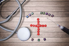 Red cross symbol and stethoscope Stock Images