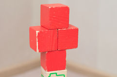 Red cross of toy cubes Royalty Free Stock Photo