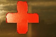 Red cross on window. Old red cross sign on window Stock Photos