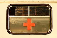 Red cross on window. Old red cross sign on window stock images