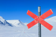 Red cross on a winter trail. Stock Photography