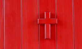 Red cross. Wooden red cross with red background Royalty Free Stock Photo