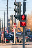 Red crossing light, car traffic and pedestrians in the city Royalty Free Stock Photo